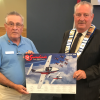 Philip Englishman presents a lithograph of the Snowbirds to Warden Alan Barfoot