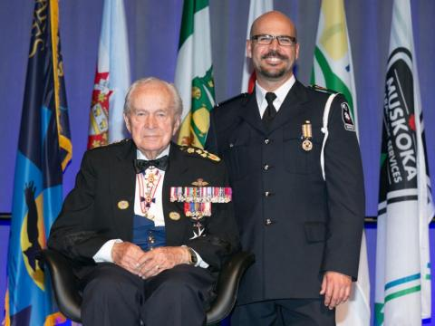 Mike LaRacque stands next to Honorary Lieutenant-General Richard Rohmer