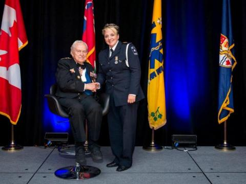 Diana Graham accepts Exemplary Service Medal