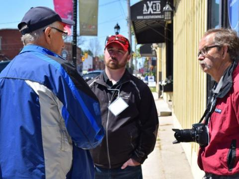 Three men stand together casually outside of Axed Throwing Club in Thornbury.