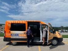 Grey County Warden Paul McQueen (left) climbing into a new Grey Transit Route vehicle with Manager Stephanie Stewart.