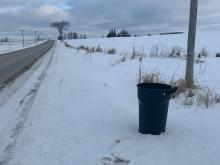Garbage can properly positioned on the roadside for collection