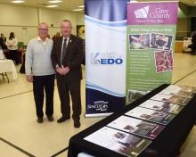 County of Simcoe Warden Gery Marshall stands beside Grey County Warden Alan Barfoot at a business to retail event.