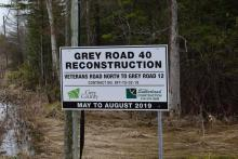 Road construction sign for Grey Road 40 with the Grey County and Harold Sutherland logos