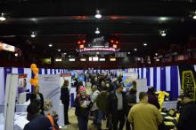 Photo of the 2020 Regional Job Fair showing businesses and job seekers on the arena floor at the bayshore