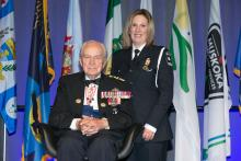 Jodi MacInnis stands next to Honorary Lieutenant-General Richard Rohmer