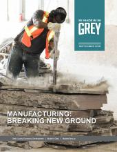 cover page of Made in Grey magazine showing a man prying at a large chunk of stone.