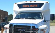 "image of a small buss with a front sign that reads ""Rural Route"""