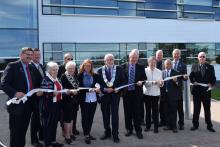 County Council cuts the ceremonial ribbon in front of the Grey County Administration Building
