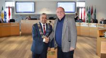 Warden Selwyn Hicks shakes hands with Town of the Blue Mountains alternate councillor Rob Potter