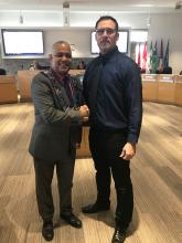 Warden Hicks shakes hands with newly sworn in alternate councillor Shawn Greig