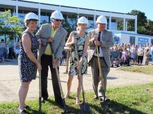 Kim Wingrove, Dwight Burley, Anne Marie Shaw and Grey County Warden Barfoot use shovels to take the first scoops of soil in front of the administration building.