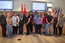 Participants in the Starter Company program stand with Warden Halliday and BEC staff in the Council Chamber