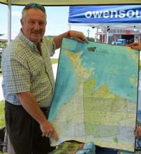 Warden Alan Barfoot shows a sneak peek of the 2017-2018 Grey County Official Map.
