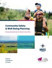 Cover of the Community Safety and Well-Being Plan - image of a man with a child on his shoulders walking in nature.