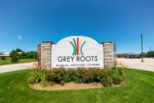 Grey Roots Welcome Sign in Summer