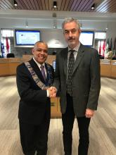Warden Hicks shakes hands with newly sworn in alternate councillor Geoffrey Shae